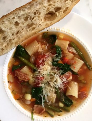 bowl of minestrone soup with a slice of crusty bread