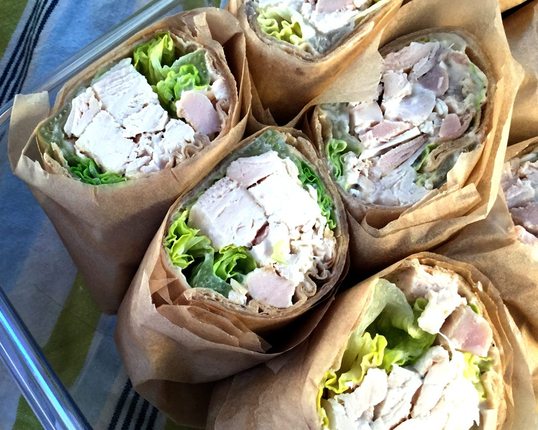 chicken caesar wraps are filled with tender chunks of chicken bathed in Caesar dressing alongside romaine lettuce.