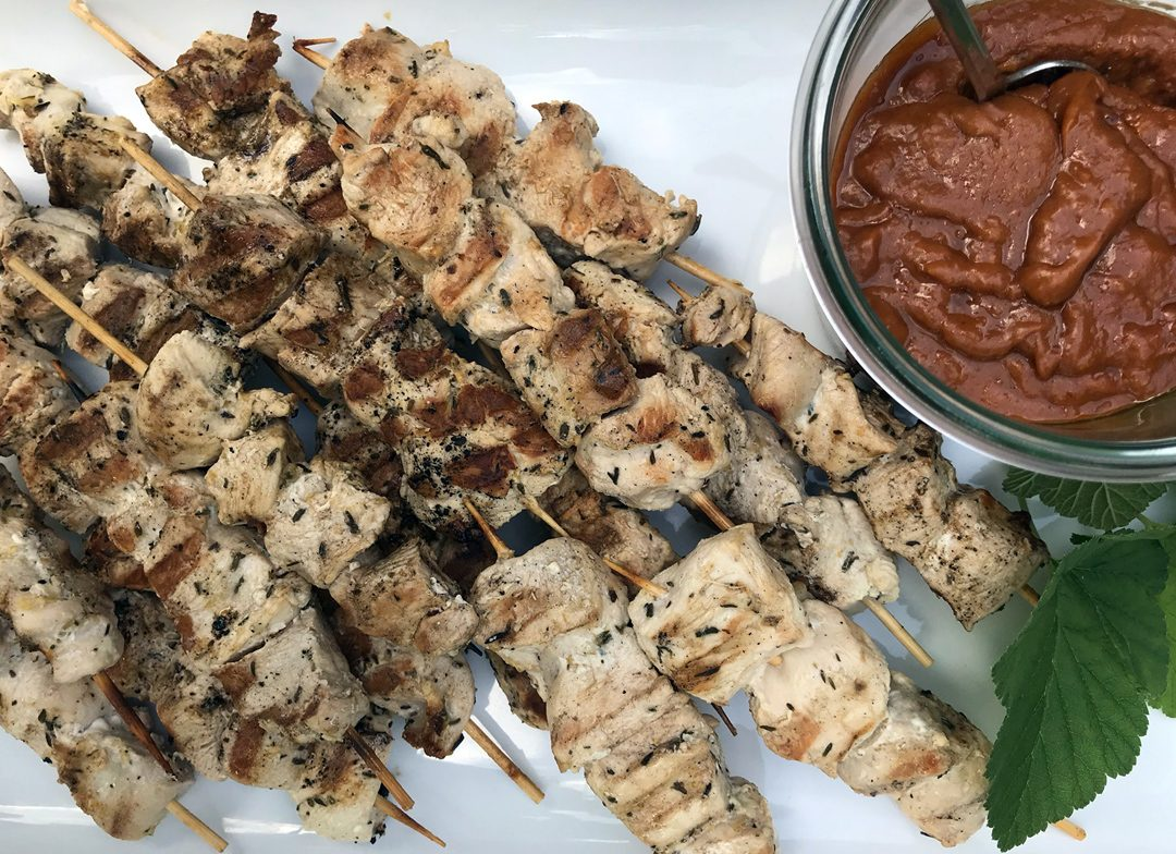 illustrate grilled chicken skewers with peanut sauce