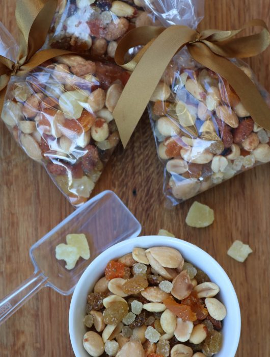 bags of golden gorp with a scoop and bowl of ready to eat trail mix