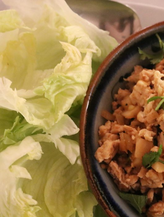 Chicken lettuce wraps the easy way with simple hoisin sauce and crunchy green head lettuce leaves